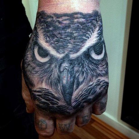 Owl head tattoo on the fist