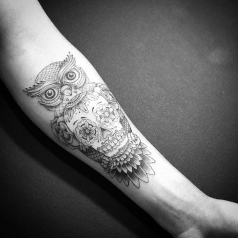 Owl tattoo on the forearm