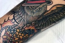 Owl with hat tattoo on the arm