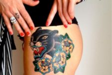 Panther and yellow flowers tattoo on the thigh