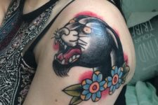 Panther head and blue flowers tattoo