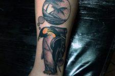 Penguin thinking of beach tattoo