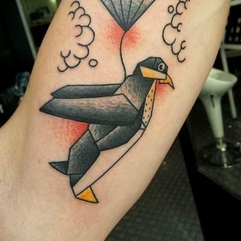 Penguin with balloon tattoo