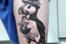 Penguin with cocktail tattoo on the leg