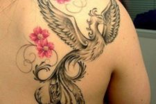 Phoenix and pink flowers tattoo on the back and shoulder