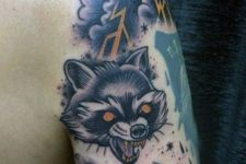 Raccoon and storm cloud tattoo