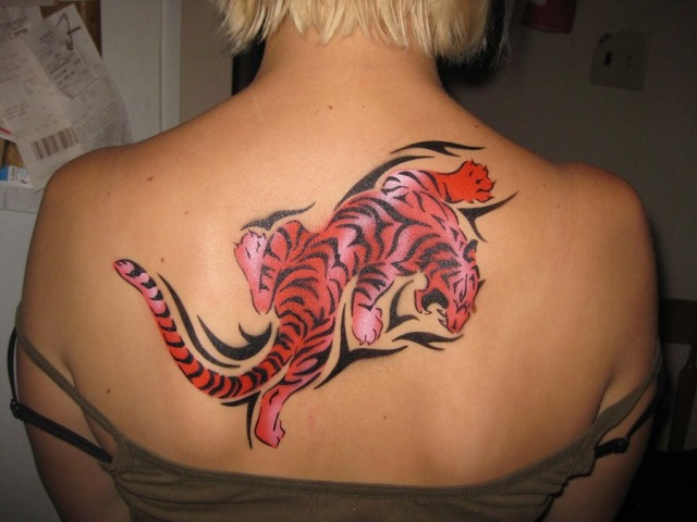 Red and black tiger tattoo on the back