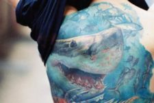 Shark and other fishes tattoo on the back