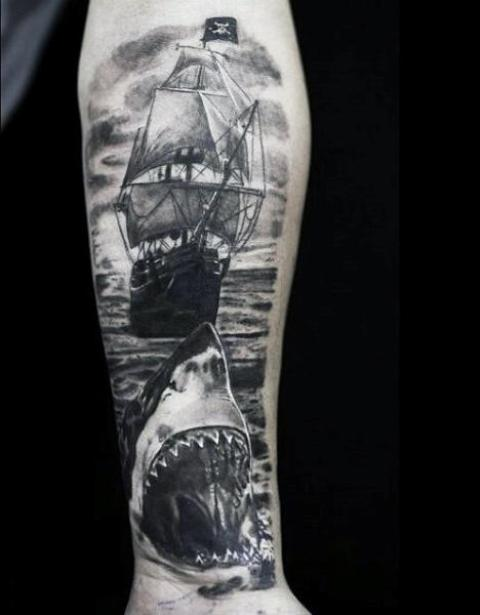 Picture Of Shark and ship tattoo on the arm
