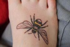 Simple bee tattoo on the foot