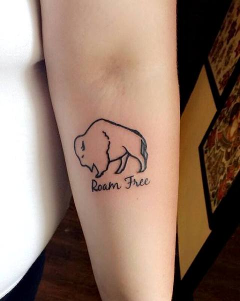 Small black-contour tattoo on the forearm