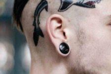 Small shark tattoo on the head