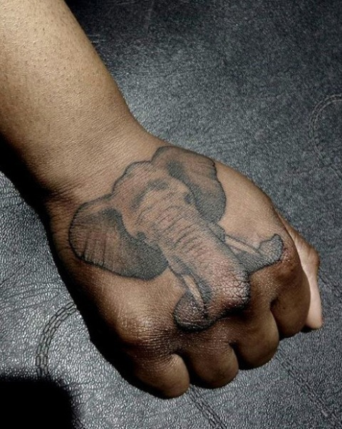 Small tattoo on the fist