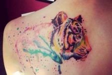 Tiger tattoo with colorful splashes