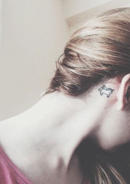 Tiny tattoo behind the ear