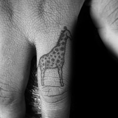 Tiny tattoo on the finger