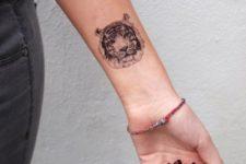 Tiny tattoo on the wrist