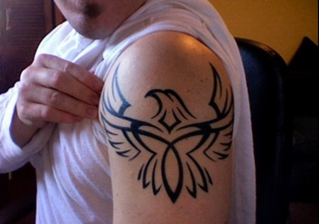 Tribal eagle tattoo on the shoulder
