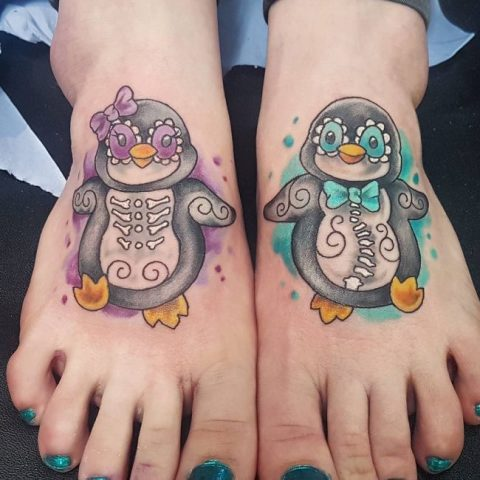 Two colorful tattoos on both feet