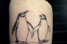 Two cute penguins tattoo