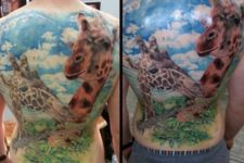 Two giraffes tattoo on the back