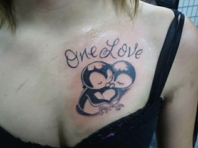 Two penguins tattoo on the chest