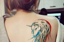 Unicorn head tattoo on the red and blue background