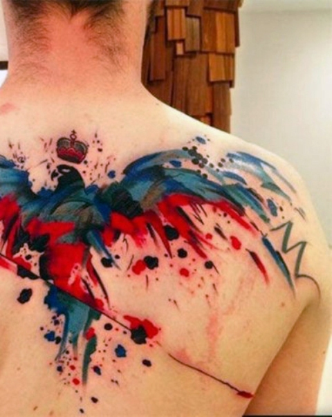 Watercolor blue and red tattoo on the back