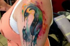 Watercolor mother penguin and baby penguin tattoo