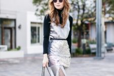 With black turtleneck, gray dress, glitter skirt and sneakers