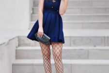 With navy blue dress, embellished boots and clutch