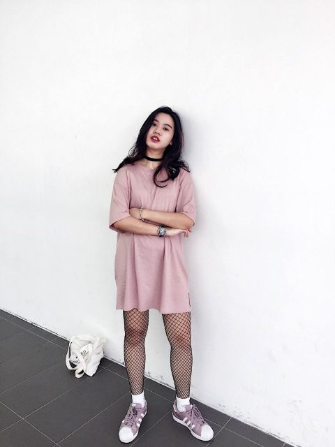 With pale pink loose dress, white socks and pink and white sneakers