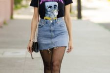 With printed t-shirt, denim high-waisted skirt and sneakers