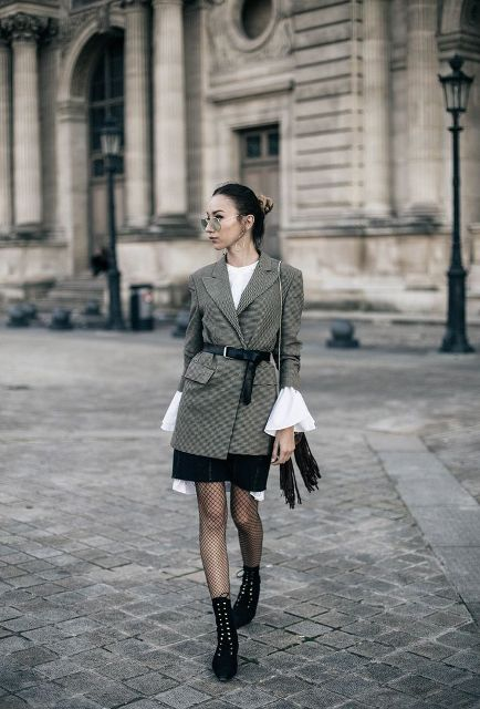 With white blouse, black skirt and gray cardigan
