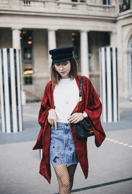 With white shirt, denim skirt and cap