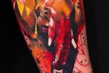 Yellow, red, orange elephant tattoo on the arm