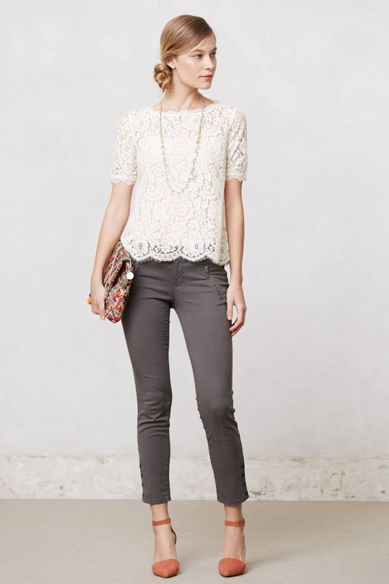 a lace crop top with short sleeves, grey cropped jeans, coral shoes and a bold clutch
