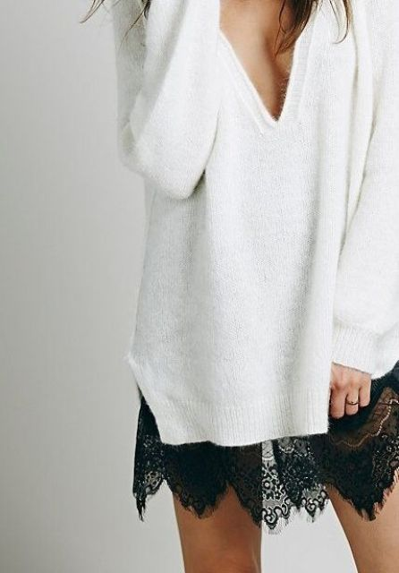 a black lace skirt and a white oversized deep V neckline sweater for a sexy look