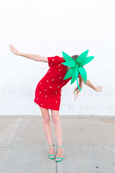a cute strawberry costume with a red mini dress with white polka dots attached, green shoes and a green hat