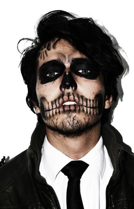 gorgeous skull makeup and a costume with a tie looks wow