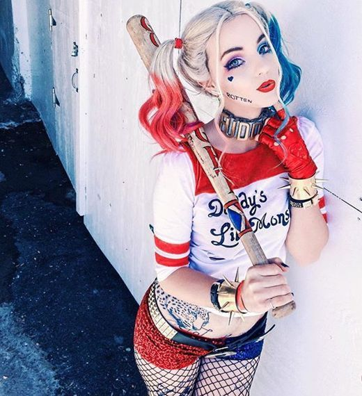 sexy and colorful Harley Quinn costume with red and blue glitter shorts, net tights, a bold top and hair dying