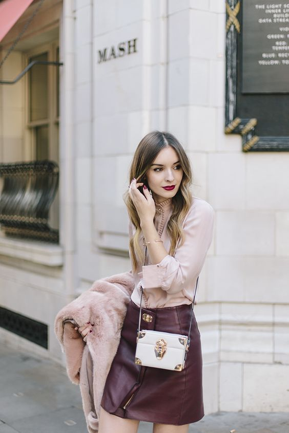 a burgundy leather mini, a blush blouse, a blush coat if necessary