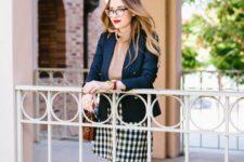 03 a plaid skirt, tall burgundy boots, a neutral turtleneck and a navy blazer
