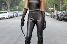04 Cat Woman costume of black leather – tall boots, a mask, gloves and a jumpsuit