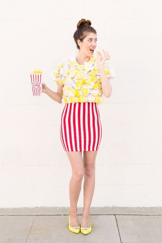 colorful and fun popcorn costume with a striped red and white mini skirt, a whimsy popcorn shirt, yellow shoes