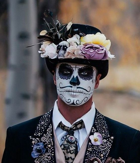a sugar skull makeup and a bold costume for those who love Mexico