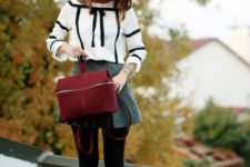 06 a grey A-line skirt, a white shirt with black ribbon, black tights, black tall boots and a red suede bag
