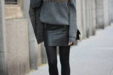 06 a grey sweater, a black mini skirt, black tights and black suede booties for a cute look