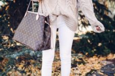 06 a neutral oversized sweater, white jeans, brown suede booties and a large bag