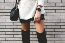 06 a white deep V-neck sweater over a black lace dress, tall black suede boots and a black crossbody